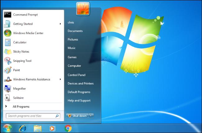 Le menu Démarrer s'ouvre sur un bureau Windows 7.